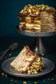 Crepe (pancakea) cake with chocolate and nuts — Stock Photo