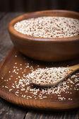 Organic quinoa grain on rustic background — Stock Photo