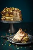Crepe cake with chocolate and nuts — Stock Photo
