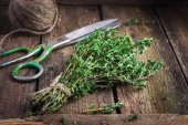Thyme bunch on an old wooden background — Stock Photo