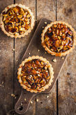 Tart with nuts and caramel — Stock Photo