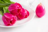 Spring table setting with tree pink tulip and candle egg for Eas — Stock Photo