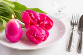 Spring table setting with tree pink tulip and candle egg for Easter — Stock Photo