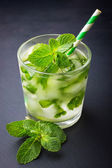 Cold fresh lemonade with mint and ice — Stock Photo