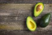 Food background with fresh organic avocado on  old wooden table — Stock Photo