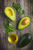 Food background with fresh organic avocado, lime, parsley and ol — Stock Photo