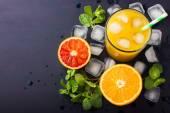 Fresh orange juice on dark background — Stock Photo