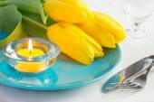 Spring table setting with yellow tulips  — Stock Photo