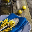 Easter table setting with spring flower and eggs on wooden backg — Stock Photo #67422537