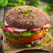 Healthy fast food. Vegan rye burger with fresh vegetables — Stock Photo