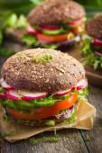 Healthy fast food. Vegan rye burger with fresh vegetables — Stock Photo