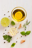 Ingrediets for salad dressing. Olive oil, garlic, lemon, herbs a — Stock Photo
