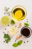 Ingrediets for salad dressing. Olive oil, garlic, balsamic vineg — Stock Photo