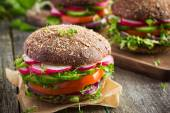 Vegan rye burger with vegetables — Stock Photo