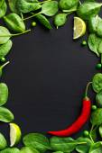 Spinach and red chili pepper — Stock Photo