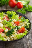 Pasta salad with cherry tomatoes — Stock Photo