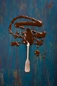 Spoon with melted chocolate — Stock Photo