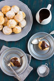 Profiteroles with cream and chocolate sauce — Stock Photo