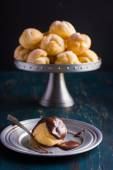 Profiteroles with cream and chocolate sauce — Stock Photo