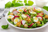 Salad with chicken and quail eggs — Stock Photo