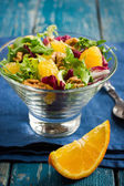 Salad with orange and walnuts — Stock Photo