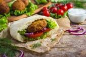 Falafel with fresh vegetables in pita bread — Stock Photo
