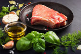Pork chops with spices and herbs — Stock Photo