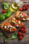 Bruschetta with tomato and feta cheese — Stock Photo