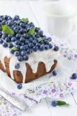 Blueberry cake with sugar icing — Stock Photo