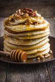 Pancakes with banana and honey — Stock Photo