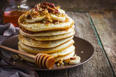 Pancakes with banana and honey — Stock Photo