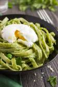 Tagliatelle pasta with spinach — Stock Photo