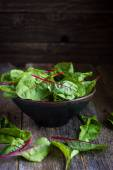 Fresh chard leaves on rustic background — Stock Photo
