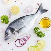 Fresh raw dorado fish with spices — Stock Photo