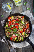 Whole wheat fusilli pasta  with vegetables — Stock Photo