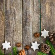 Christmas background with fir branches, pine cones, christmas co — Стоковое фото #84483490
