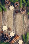 Christmas background with fir branches, pine cones, christmas co — Stock Photo