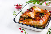 Roasted chicken leg with orange and spicy herbs — Stock Photo