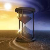 The flow of time and hourglass — Stock Photo