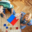 Young couple painting furniture at home — Stockfoto #61111851