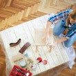 Young woman sanding furniture at home — Stock Photo #61111881