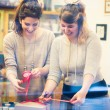 Two women packing gifts — Stock Photo #61112211