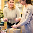 Two women packing gifts — Stock Photo #61112665