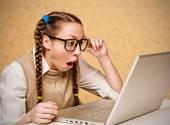 Female nerd at the laptop. — Stock Photo
