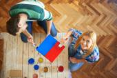 Young couple painting furniture at home — Stockfoto