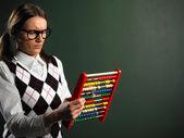 Female nerd holding abacus — Stock Photo