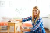 Woman sanding furniture — Stock Photo