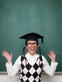 Female nerd with raised arms — Stock Photo