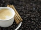 Cup of espresso on coffee beans — Stock Photo