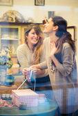 Two women packing gifts — Zdjęcie stockowe